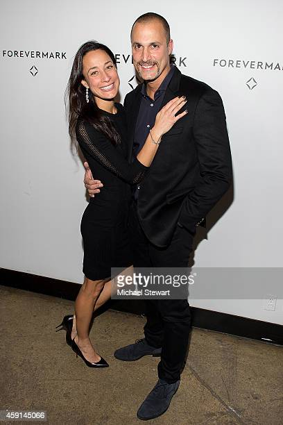 Cristen Barker and photographer Nigel Barker attend Hold My Hand Forever Exhibition By Forevermark at Highline Studios on November 17 2014 in New...