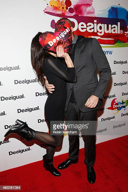 Cristen Barker and photographer Nigel Barker pose backstage at the Desigual fashion show during MercedesBenz Fashion Week Fall 2015 at The Theatre at...