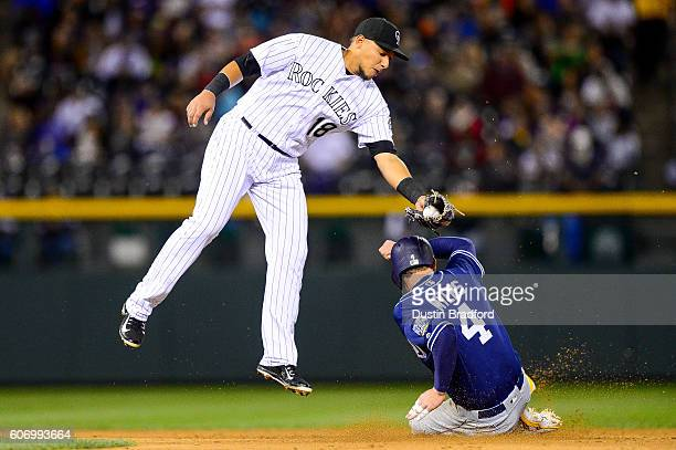 Cristhian Adames of the Colorado Rockies applies a tag on Wil Myers of the San Diego Padres who was tagged out attempting to steal second base to end...