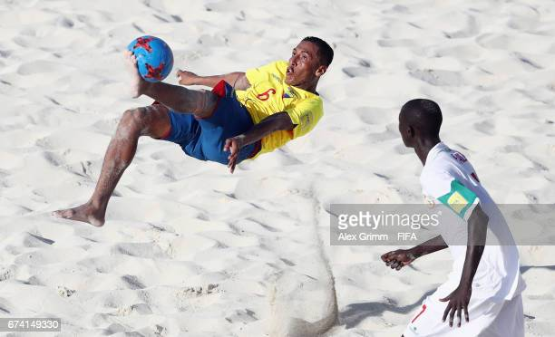 Cristhian Gallegos of Ecuador attempts a bicycle kick next to Babacar Fall of Senegal during the FIFA Beach Soccer World Cup Bahamas 2017 group A...