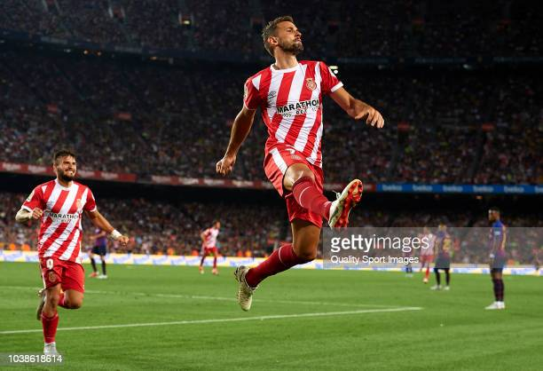Cristhian Stuani of Girona celebrates after scoring his sides second goal during the La Liga match between FC Barcelona and Girona FC at Camp Nou on...