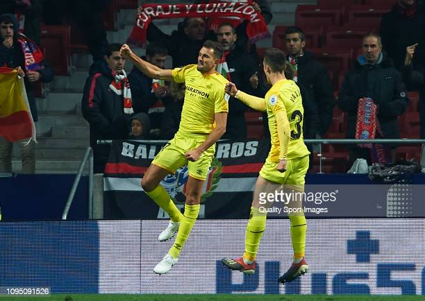 Cristhian Stuani of Girona celebrates after scoring his sides second goal with his teammate Valery Fernandez during the Copa del Rey Round of 16...