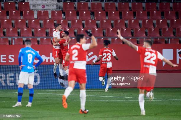 Cristhian Stuani of Girona FC celebrates with teammates after scoring the opening goal during the LaLiga SmartBank match between Girona FC and UD...