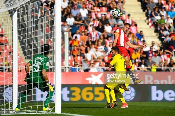 Cristhian Stuani of Girona FC heads the ball towards goal during the La Liga match between Girona and Villarreal at Estadi de Montilivi on October 15...