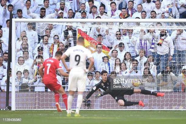 Cristhian Stuani of Girona scores his team's first goal from the penalty spot during the La Liga match between Real Madrid CF and Girona FC at...