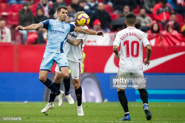 Cristhian Stuani of Girona Simon Kjaer of Sevilla FC Ever Banega of Sevilla FC during the La Liga Santander match between Sevilla v Girona at the...