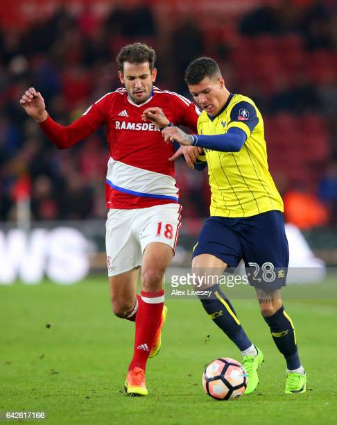 Cristhian Stuani of Middlesbrough and Marvin Johnson of Oxford United battle for possession during The Emirates FA Cup Fifth Round match between...
