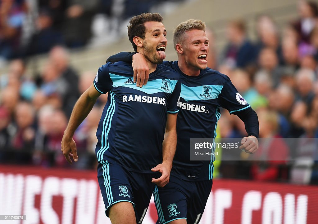 Cristhian Stuani of Middlesbrough (L) celebrates scoring his sides first goal with his team mate during the Premier League match between West Ham United and Middlesbrough at London Stadium on October 1, 2016 in London, England.