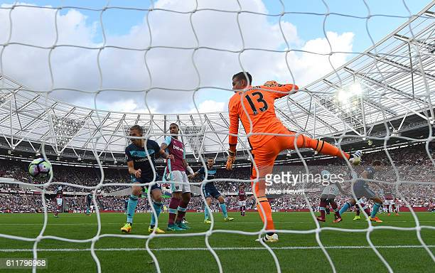 Cristhian Stuani of Middlesbrough scores his sides first goal during the Premier League match between West Ham United and Middlesbrough at London...