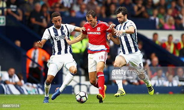 Cristhian Stuani of Middlesbrough takes on Brendan Galloway and Claudio Yacob of West Bromwich Albion during the Premier League match between West...