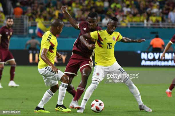 Cristian Alexis Borja of the Colombian National Team battles for the ball against Sergio Cordova of the Venezuelan National Team during the friendly...