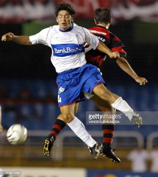 Cristian Alvarez of Universidad Catolica of Chile fights for the ball against brazilian Leandro Machado of the Flamengo de Rio during the Copa...