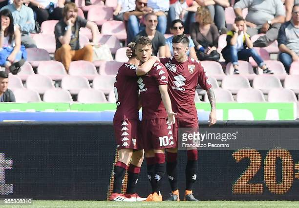 Cristian Ansaldi Adem Ljajic and Daniele Baselli of Torino FC celebrate the 11 goal scored by Daniele Baselli during the serie A match between SSC...