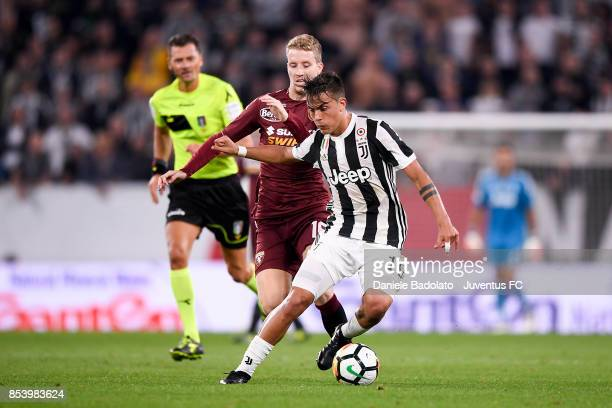 Cristian Ansaldi and Paulo Dybala during the Serie A match between Juventus and Torino FC on September 23 2017 in Turin Italy