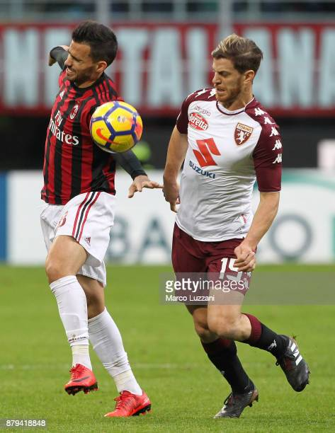 Cristian Ansaldi of AC Milan competes for the ball with Cristian Ansaldi of Torino FC during the Serie A match between AC Milan and Torino FC at...