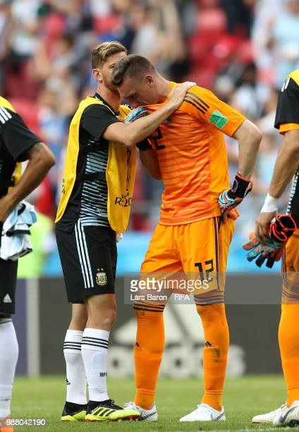 Cristian Ansaldi of Argentina and Franco Armani of Argentina look dejected following their sides defeat in the 2018 FIFA World Cup Russia Round of 16...