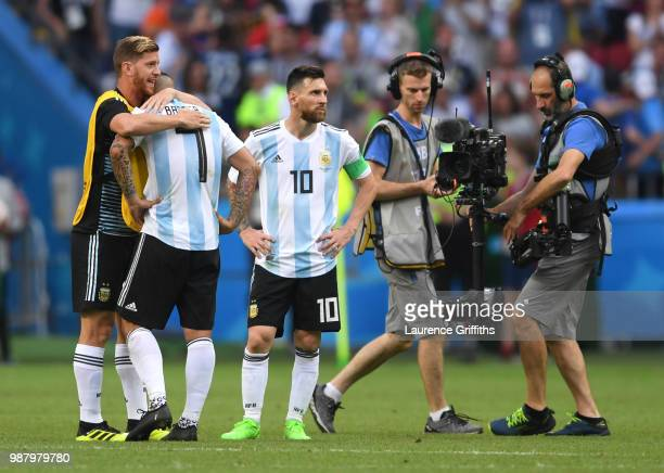 Cristian Ansaldi of Argentina consoles teammate Ever Banega of Argentina following their sides defeat in the 2018 FIFA World Cup Russia Round of 16...