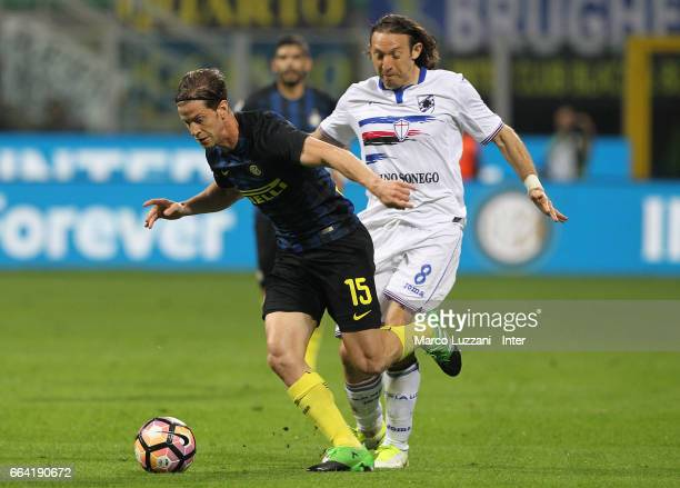 Cristian Ansaldi of FC Internazionale competes for the ball with Edgar Barreto of UC Sampdoria during the Serie A match between FC Internazionale and...