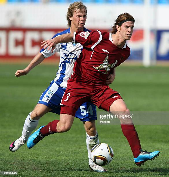 Cristian Ansaldi of FC Rubin Kazan battles for the ball with Alexey Vasiliev of FC Sibir Novosibirsk during the Russian Football League Championship...