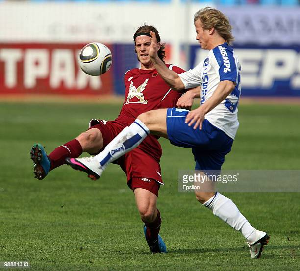 Cristian Ansaldi of FC Rubin Kazan battles for the ball with Alexander Makarenko of FC Sibir Novosibirsk during the Russian Football League...