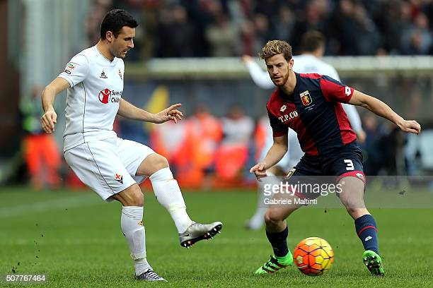 Cristian Ansaldi of Genoa CFC battles for the ball with Manuel Pasqual of ACF Fiorentina during the Serie A match between Genoa CFC and ACF...