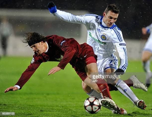 Cristian Ansaldi of Russia's Rubin Kazan vies with Andriy Shevchenko of Ukraine's Dynamo Kiev during their UEFA Champions league football match in...