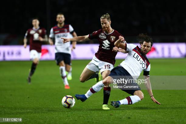 Cristian Ansaldi of Torino FC and Andrea Poli in action during the Serie A football match between Torino Fc and Bologna Fc Bologna Fc wins 32 over...