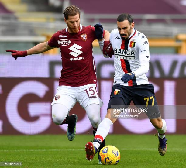 Cristian Ansaldi of Torino FC battles for possession with Davide Zappacosta of Genoa during the Serie A match between Torino FC and Genoa CFC at...
