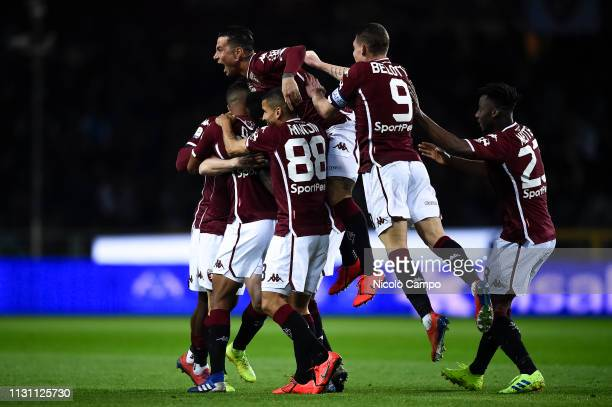 Cristian Ansaldi of Torino FC celebrates with his teammates after causing a own goal during the Serie A football match between Torino FC and Bologna...