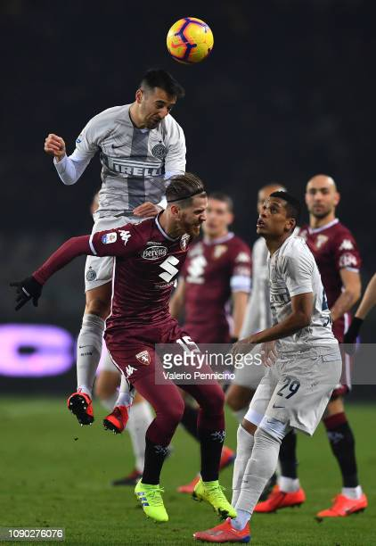 Cristian Ansaldi of Torino FC clashes with Matias Vecino of FC Internazionale during the Serie A match between Torino FC and FC Internazionale at...