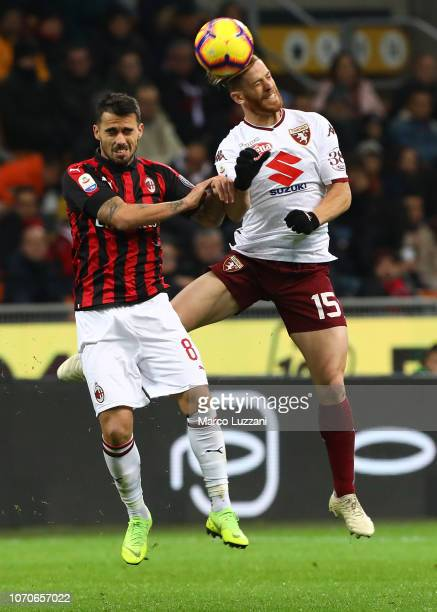 Cristian Ansaldi of Torino FC competes for the ball with Fernandez Suso of AC Milan during the Serie A match between AC Milan and Torino FC at Stadio...