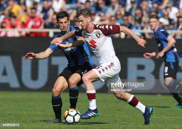 Cristian Ansaldi of Torino FC competes for the ball with Remo Freuler of Atalanta BC during the serie A match between Atalanta BC and Torino FC at...