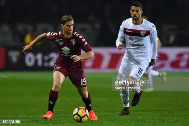 Cristian Ansaldi of Torino FC in action against Paolo Farago of Cagliari Calcio during the Serie A match between Torino FC and Cagliari Calcio at...