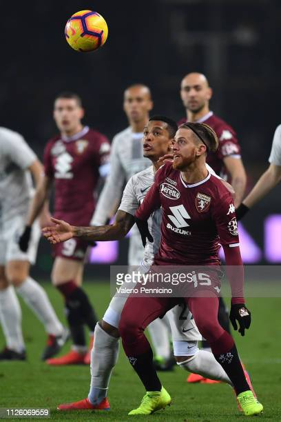 Cristian Ansaldi of Torino FC is challenged by Estevao Dalbert of FC Internazionale during the Serie A match between Torino FC and FC Internazionale...