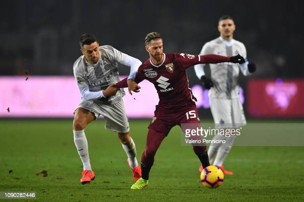Cristian Ansaldi of Torino FC is challenged by Matias Vecino of FC Internazionale during the Serie A match between Torino FC and FC Internazionale at...