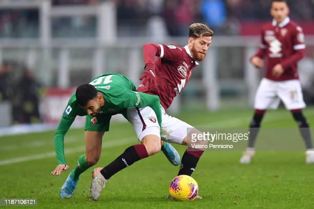 Cristian Ansaldi of Torino FC is challenged by Rachid Ghezzal of ACF Fiorentina during the Serie A match between Torino FC and ACF Fiorentina at...