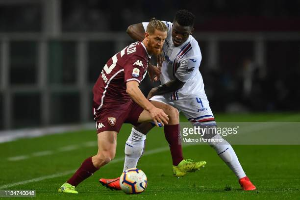 Cristian Ansaldi of Torino FC is challenged by Ronaldo Vieira of UC Sampdoria during the Serie A match between Torino FC and UC Sampdoria at Stadio...