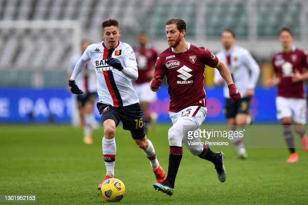 Cristian Ansaldi of Torino FC runs with the ball under pressure from Miha Zajc of Genoa C.F.C. During the Serie A match between Torino FC and Genoa...