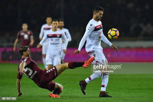 Cristian Ansaldi of Torino FC tackles Paolo Farago of Cagliari Calcio during the Serie A match between Torino FC and Cagliari Calcio at Stadio...
