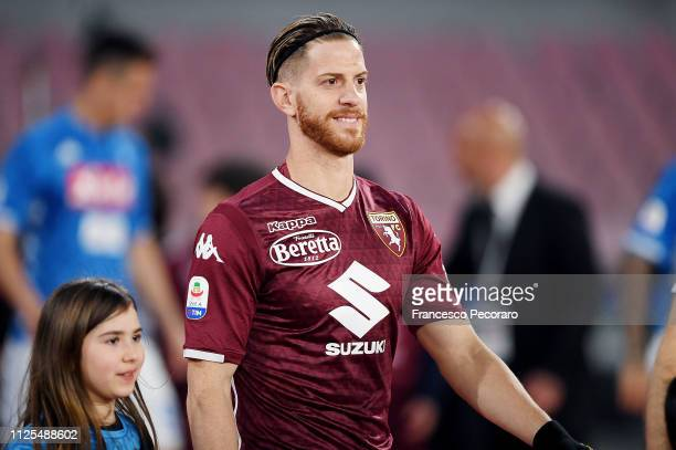 Cristian Ansaldi of Torino FC walks in the soccer pitch with a ball girl before the Serie A match between SSC Napoli and Torino FC at Stadio San...