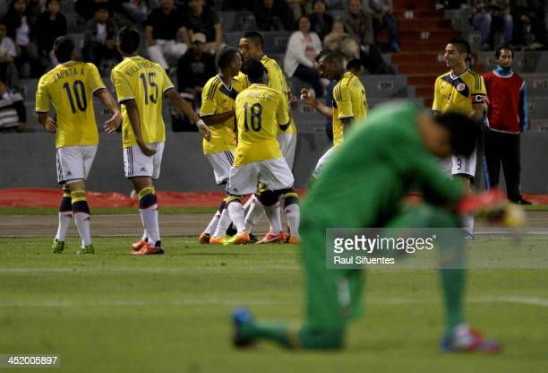 Cristian Arango of Colombia celebrates with his teammates a scored goal against Ecuador during the football final match between Colombia and Ecuador...