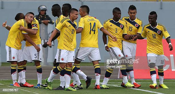 Cristian Arango of Colombia celebrates with teammates after scoring during the U18 soccer match between Colombia and Bolivia as part of the XVII...