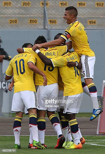 Cristian Arango of Colombia covered by teammates celebrates after scoring during the U18 soccer match between Colombia and Bolivia as part of the...