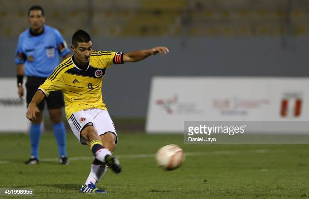 Cristian Arango of Colombia takes a penalty kick to score his third goal during the football final match between Colombia and Ecuador as part of the...