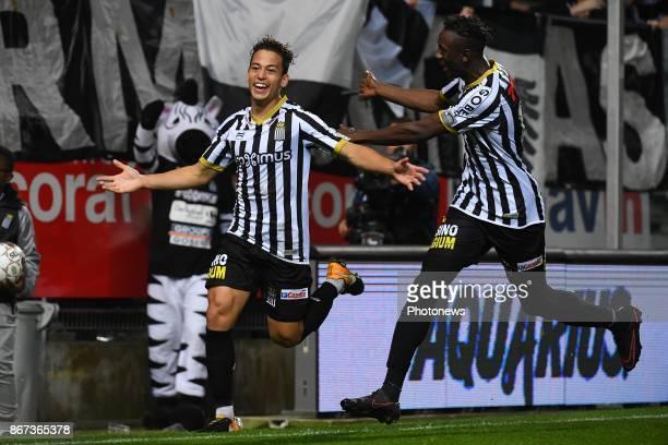 Cristian Benavente midfielder of Sporting Charleroi celebrates scoring a goal with teammates Amara Baby midfielder of Sporting Charleroi during the...