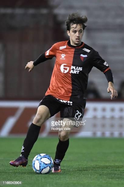 Cristian Bernardi drives the ball during a match between Huracán and Colón as part of Superliga Argentina 2019/20 at Tomas Adolfo Duco Stadium on...