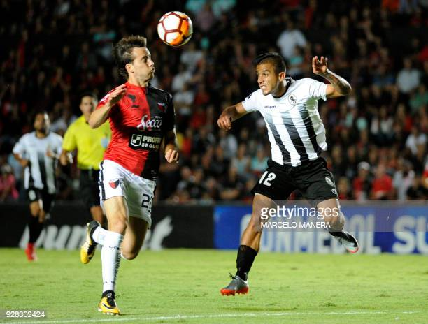 Cristian Bernardi of Argentina's Colon and Mayker Gonzalez of Venezuela's Zamora vie for the ball during their Copa Sudamericana football match at...