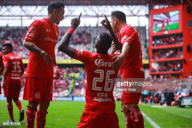 Cristian Borja of Toluca celebrate with teammates after scoring the first goal of his team during the quarter finals second leg match between Toluca...