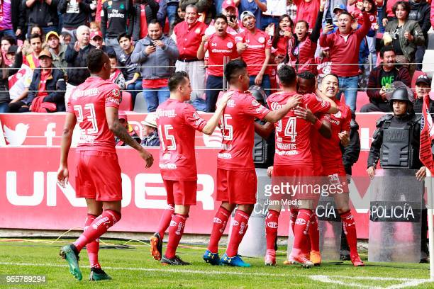 Cristian Borja of Toluca celebrates with teammates after the first goal of his team during the quarter finals second leg match between Toluca and...