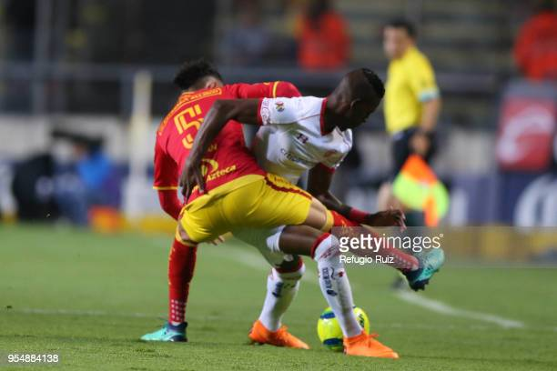 Cristian Borja of Toluca fights for the ball with Carlos Guzman of Morelia during the quarter finals first leg match between Morelia and Toluca as...